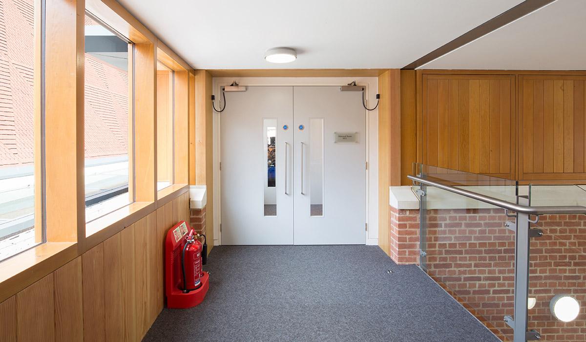 Shadbolt_paint_lacquered_fire_doors_at_KCS_New_Music_School
